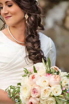 From soft waves to gorgeous updos and ponytails, brides have so many hairstyles to consider. See our gallery of braided wedding hair ideas for inspiration!