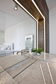 Housing Building With 7 Units by Metaform Architecture. Beautiful joinery with the marble sink and recessed strip lighting