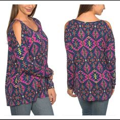 Cold shoulder Aztec top Rayon spandex blend. Runs a tad on the big size, please ask any specific questions regarding what size will fit you best. 15% off retail bundles.  Tops Tees - Long Sleeve