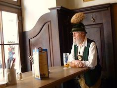 A local in Munich stops in for an Augustiner beer in traditional Bavarian dress