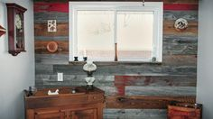 Barn board covered accent wall. Giving extended life to some one hundred year old reclaimed barn board.