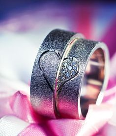 Great detail shot of Fabulous Matching Wedding Rings - I love the half hearts.