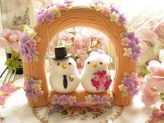 Custom Wedding Cake Topper -Handmade love birds with love flower tree and a swing,SWAROVSKI crystals. $180.00, via Etsy.