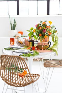 A perfectly sophisticated Halloween dinner table setting for friends, family, or even a spooky dinner date night this Fall!