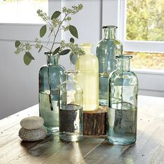 Shop recycled glass jars from west elm. Find a wide selection of furniture and decor options that will suit your tastes, including a variety of recycled glass jars. Recycled Glass Bottles, Vintage Bottles, Bottles And Jars, Bottle Candles, Antique Bottles, Bottle Vase, Decoration Table, Vases Decor, Decorations