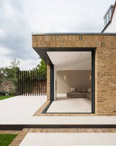 IQ Glass supplied our admired sliding glass doors to this contemporary extension space in Barnet. The small glazed extension was a new addition to a detached Victorian home Brick Extension, Orangery Extension, House Extension Design, Extension Designs, Glass Extension, Extension Ideas, Kitchen Extension Exterior, Garage Extension, Corner Bifold Doors