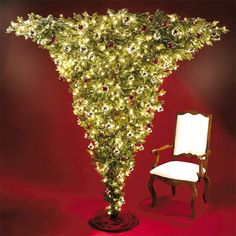 Evoking a 12th century Central European tradition of hanging a tree from the ceiling at Christmas, this unique 7′ pre-lit fir is inverted to ensure a smaller footprint for less-spacious areas, and allowing more room for the accumulation of presents underneath.