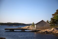 snøhetta reconstructs boat house on the shores of norwegian island - designboom | architecture