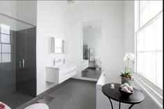 White walls grey floors in the bathroom