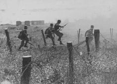 Romanian soldiers overcoming barbed wire fence on the Eastern Front, date and location unknown - pin by Paolo Marzioli Troops, Soldiers, Axis Powers, Oriental, Cold War, Armed Forces, World War Ii, Wwii, Battle