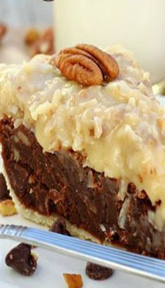 German chocolate cake fudge-like pie, topped with classic homemade coconut pecan frosting. The chocolate filling is loaded with semi-sweet chocolate chips and pecans, and tastes a lot like a dense, chewy brownie. It was hard … Chocolate Fudge Pie, German Chocolate Pies, Chocolate Desserts, Chocolate Filling, Chocolate Frosting, Decadent Chocolate, German Chocolate Cheesecake, Coconut Chocolate, Fudge Cake