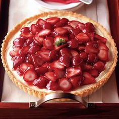Only the crust needs to be baked for this cheesecake, complemented with fresh strawberries.