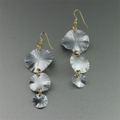 The hand-chased design of these #Aluminum three-tiered Lily Pad #earrings makes them a work of art anyone can appreciate.  These super light-weight earrings are guaranteed to turn heads. $75
