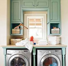 Love the idea of a folding table above washer/dryer. This would work in my laundry room! Love it.