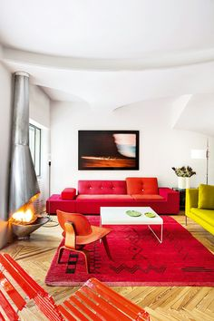 Colorful furniture and white walls.