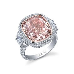Brides.com: Pink Engagement Rings. Natural fancy pink-colored cushion shape diamond encrusted in white diamonds set in platinum, price upon request, Neil Lane  See more cushion-cut engagement rings.