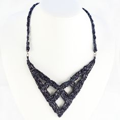This necklace makes a fierce statement with its bold design and glistening gunmetal beadwork. This necklace would look great with a low-cut v-neck dress!