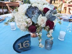 Succulent Peony centerpiece. St . Francis Winery wedding reception flowers- Fleurs de France. www.fleursfrance.com