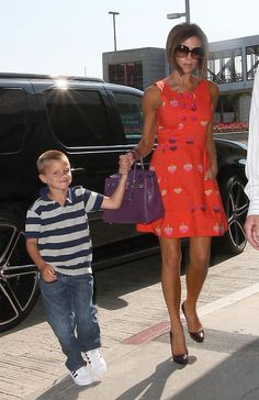 Where can I get Victoria Beckham's red dress, purple purse, shoes and sunglasses?
