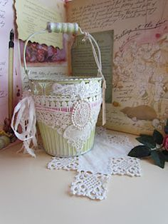 this beautiful pail would make a lovely centerpiece at a wedding or baby shower filled with pretty wrapped gifts for the honoree.  Angela Lace has a gorgeous blog.