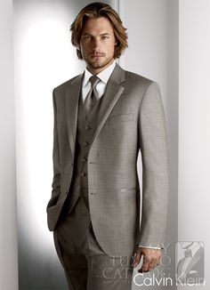 Grey 'Legend' Tuxedo from MyTuxedoCatalog.com Love it!! Grey on grey. Let the peach come in with the boutennier! Classy!