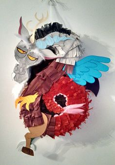 This is a hand made pinata that I made of Discord for my daughter's MLP FIM birthday party this year. I couldn't have done it without the help of a pin I found earlier (http://thefrugalcrafter.wordpress.com/2011/09/20/how-to-make-a-shaped-pinata/)