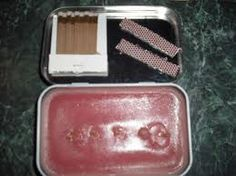 An Altoids Tin!!  Cool use for an emergency candle