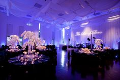 Reception decor featuring phalenopsis and floating candles #NewberryBros #Denver #Wedding