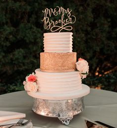 Pro tip: Gold cakes are one of our favorite trends of the season, and it's easy to see why! Pair yours with cream for a more traditional look, or add a pop of color with warm peach hues. http://www.orlandocustomcakes.com/ Thanks to: Justin Gilbert Photography, Perry L. Oakley-Makeup Artist, Cypress Grove Estate House, Adamson Calligraphy, and Andi Mans.