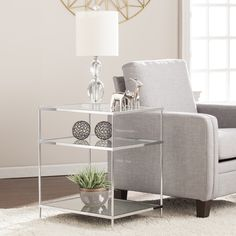Knox Glam Mirrored Side Table in Chrome - Southern Enterprises to flapper style with this oh so glam side table. High shine chrome metal melds with reflective mirror and shimmering glass, crafting a sleek, elegant look. Mirrored Accent Table, Mirrored Side Tables, Accent Tables, Modern End Tables, Sofa End Tables, Coffee Tables, Furniture Deals, Quality Furniture, Furniture Outlet