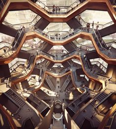 Designed by Thomas Heatherwick, founder of London's Heatherwick Studio, the Vessel will include 154 flights of stairs, which intersect to form an Escher-esque lattice of infinite walkways. The structure will have nearly 2,500 steps and 80 landings, totaling a mile of pathway above the plazas and gardens below.