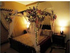 The bedroom is just one of the most sacred rooms of your house and you need to treat it like one. Floral arrangements are complete through local florists. Wedding Night Room Decorations, Bridal Room Decor, Indian Wedding Decorations, Indian Weddings, Bedroom Bed Design, Bedroom Decor, Wedding Bed, Wedding Bottles, Bedroom Night