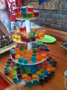 Shots, or jello shots. Like this display idea. You could easily decorate this for Halloween and it would look amazing!