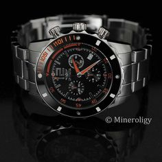 - About - Specs - Size Show some style with this masterfully designed timepiece from Invicta's Specialty Collection. The stunning black dial and bezel feature three chronograph subdials, a date window