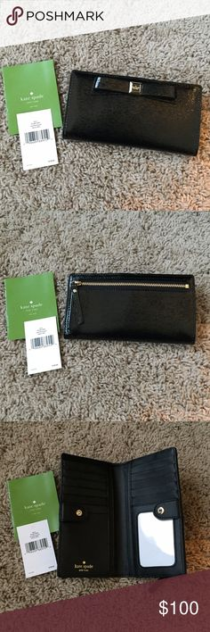 Kate Spade patent black wallet This is a NWT never used black patent Kate Spade wallet. This is beautiful. It has 7 card spaces on one side and 6 card spaces on the other with clear pocket for an ID. It also has two long open pockets on both sides perfect for dollar bills. It has a zipper pocket on the back. Perfect condition. No lowballing please. kate spade Bags Wallets