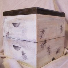 I was given a box to paint for a charity auction. I chose to use a bee-hive as my inspiration. The top comes off to reveal a golden interior.  box, bees, honey-bee, drawing, paint, wood, container