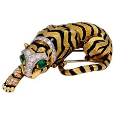 David Webb Crouching Tiger Brooch | From a unique collection of vintage brooches at https://www.1stdibs.com/jewelry/brooches/brooches/