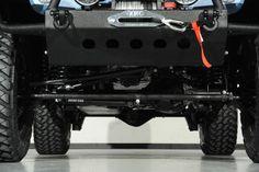2014 Jeep Wrangler Unlimited in Ferrari California Azzuro Kevlar Exterior:Custom Lift Kit