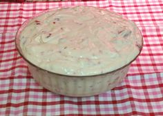 Raspberry Vanilla Jello Salad      1 box (5.1 oz) instant vanilla pudding  32 oz. (2 lb) container vanilla yogurt  8 oz. container Cool Whip (thawed)  1 pkg. frozen raspberries    Using a medium size bowl, mix together the pudding mix (dry)  and the vanilla yogurt. Stir until completely mixed together.  Add the cool whip and stir until completely mixed.  Stir in raspberries, making sure to add any juice that is in package.