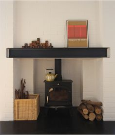 I love the idea of a wood stove nestled in a fireplace-like nook, complete with mantle.