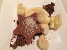 Nutella biscuit with vanilla cream, chocolate soil and toasted coconut