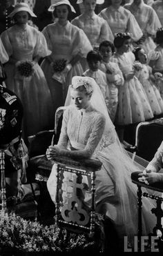 Actress Grace Kelly in gorgeous wedding gown praying during her wedding to Prince Rainier.  Location:	Monte Carlo, Monaco  Date taken:	April 19, 1956  Photographer:	Thomas D. Mcavoy