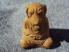 Meditating Dog Stone Coated With Brass Metal by MountainArtCasting