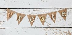 Layer paper, burlap, and punched letters and string twine through holes for a creative banner.