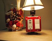 This is so cute! And so easy to plug in my phone straight into my bedside lamp. Now, if only it had a clock and alarm in it too, it would be bedside complete.   Table or Desk lamp with USB charging station for (Iphone, Blackberry, Android, etc). $90.00, via Etsy.