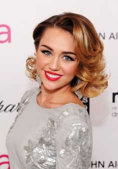 Red Carpet Makeup: Miley Cyrus sports a short do and bold lip. #makeup #fashion