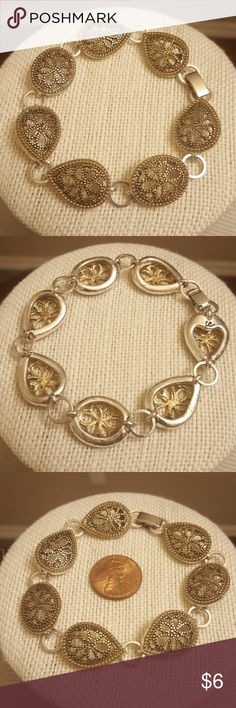 """Vtg Gold and Silver Toned Bracelet 7 1/2"""" gold and siver toned bracelet.  The top of each link is gold toned, and the sides are silver toned.  Secure fold over clasp is silver toned.  Excellent vintage condition. Jewelry Bracelets"""