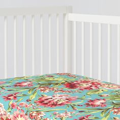 Crib Fitted Sheet in Coral and Teal Floral by Carousel Designs.