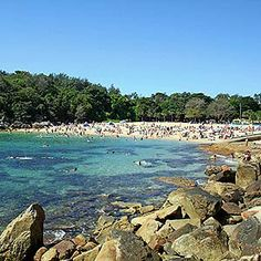 Manly Beach, Sydney Reachable via what has to be the world's most breathtaking ferry ride—the boat directly passes the city's world-famous opera house and provides on-the-water views of the towering Sydney Harbour Bridge, Manly is everything that a beach should be—soft sand, lovely water, and beautiful sunsets.