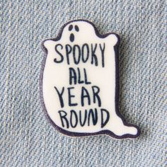 "For some of us, Halloween never ends. This handmade pin features a fat black and white ghost with the words, ""Spooky All Year Round"" on it. It is made from durable plastic with a shiny resin coating."